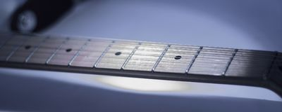 Black-and-white image. fingerboard six-string guitar. retro sty Stock Photos