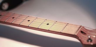 Black-and-white image. fingerboard six-string guitar. retro sty royalty free stock photography