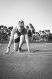 Black and white image of a Fit and happy female athlete royalty free stock photography