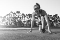 Black and white image of a Fit and happy female athlete stock image
