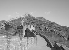 Great Wall of China: Black and white shot of section with towers winding over a mountain ridge under a clear sky stock photos