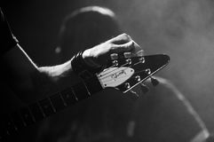 Black and White image guitar player adjusting strings stock images