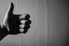 Black and white image of a hand giving a thumbs up royalty free stock photos