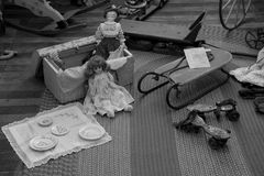 Black and white image of children`s items inside historic landmark, Starr Clark Tin Shop, Mexico, New York, 2016. Black and white image of items depicting the Royalty Free Stock Photography