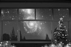 Black and white image of lonely Christmas celebration night. Beside the window of house stock photography