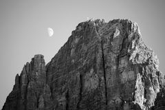 Black and white image of moon in Dolomites Royalty Free Stock Images