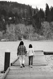 Mother and daughter on dock. Stock Photography