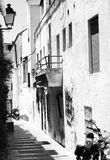 Black and white image of narrow street in Marbella, Spain Stock Photo
