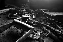 Old Antique Tools. A black and white image of old antique tools on a wooden workbench royalty free stock photography