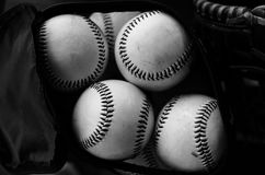 Black and white image of pile of baseballs.