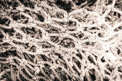 Black and white image of a pile of old fishing net. That is used and frayed stock photography