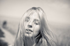 Black and white image of pretty girl with closed Stock Photos