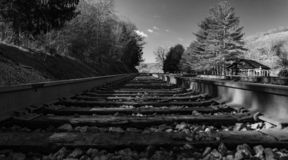 Low View of Railroad Tracks. Black and white image of railroad tracks running through the mountains located in rural southwest Virginia, USA royalty free stock image
