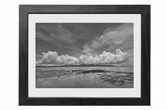 Black and white image of the sea in picture frame. Black and white image of the beautiful sea and clouds in picture frame Stock Image