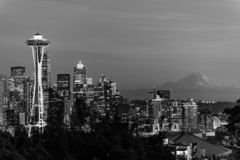 Black and white image of the skyline of the city of Seattle and the profile of Mount Rainier in the background. stock image