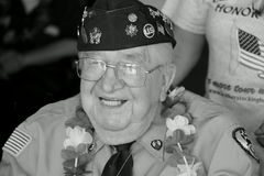 Black and white image of smiling WWII vet celebrating the day,Saratoga Racetrack,2015 Stock Photography