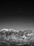 Black and white image of Snow capped mountains, blue sky, Desert Stock Image