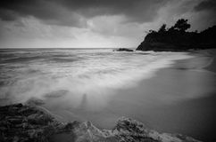 Black and white image,stunning tropical wave flow hitting sandy beach Stock Image
