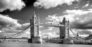 Black & white image of Tower Bridge on the River Thameswith a dramatic sky royalty free stock photos