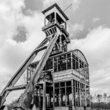 Black and white image of a towers of a mine in remodeling. A day of history and adventure in Maasmechelen Belgium stock images