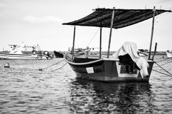 Black and white image of traditional fisherman boat moored over beautiful sea view Royalty Free Stock Image