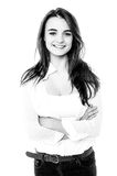 Black and white image of a trendy girl with folded arms Royalty Free Stock Photography