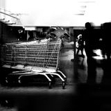 Chrome shopping carts. Black and white image of two chrome shopping carts Stock Image