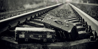 The black-and-white image of two suitcases on rails. Royalty Free Stock Photography