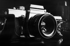 Vintage film cameras and lenses. Black and white image of vintage film cameras and lenses Stock Images