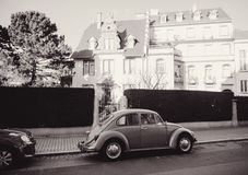 Black and white image of a vintage Volkswagen Beetle car on the Royalty Free Stock Photography