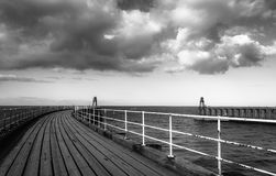 Black and white image of Whitby pier Stock Images