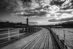Black and white image of Whitby pier Stock Image