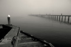 Black and white image of Winter mist over the sea. Winter mist over still water with romantic feel Stock Images