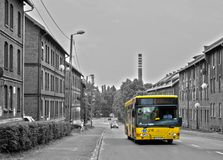 Black and white image and the yellow bus Royalty Free Stock Images