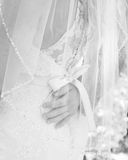 Black and white images of grooms hand resting on his brides lower back royalty free stock photos