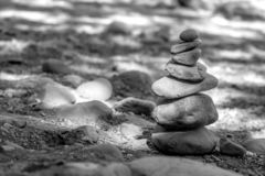 Naches River rocks stacked to create a cairn on the riverbank royalty free stock image