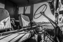 Black and white interior of WW2 Jeep with rifle across seat. HARDWICK AIRFIELD, NORFOLK, UK - APRIL 18 - The airfield hosts a unique photographic event with Stock Photography