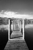 Black and White jetty on the lake. Black and White jetty leading to Lake Windermere Cumbria Stock Image