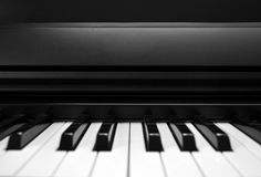 The Black (and White) Keys. Closeup of a piano in black and white Stock Photos