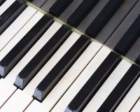 Black and white keys on old ivory keyboard of grand piano. Closeup of black and white keys on old ivory keyboard of antique bechstein grand piano Royalty Free Stock Photography