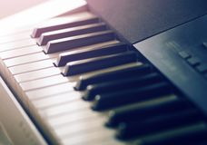 Black and white keys of the synthesizer stock photo