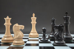 Black and White King and Knight of chess setup on Chessboard and Stock Photos
