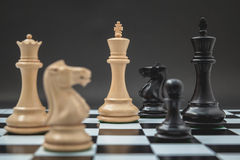 Black and White King and Knight of chess setup on Chessboard and Stock Images