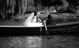 Black and white kiss in boat Stock Images