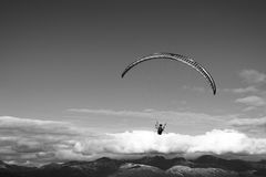 Black and white kite flyer in the sky background Royalty Free Stock Image