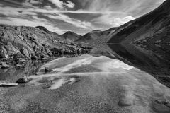 Black and white Lake District mountain landscape reflected in st. Black and white Lake District mountains landscape reflected in still lake of Wast Water Stock Image