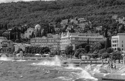 Black and white landscape of Opatija on background storm sea. Croatia, Istria Royalty Free Stock Image