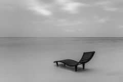 Black and white landscape of lonely sunbed on the beautiful beach Royalty Free Stock Images