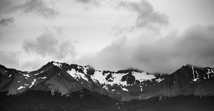 Black and white landscape panorama of Patagonian mountains, taken from the beagle channel . Ushuaia, Argentina. Dramatic landscape of Patagonian mountains, taken Royalty Free Stock Photography