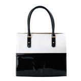 Black and white leather handbag isolated on white. Stock Images